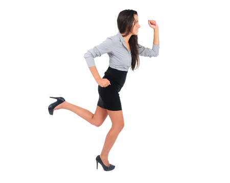 Isolated young business woman running photo