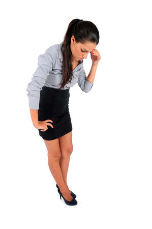 Isolated young business woman looking down photo