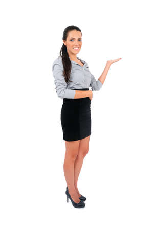 Isolated young business woman showing something photo