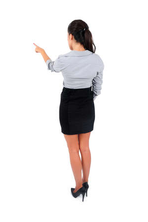Isolated young business woman pointing back  photo