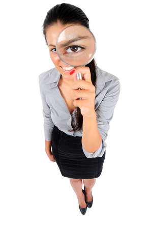 Isolated young business woman with magnifier photo
