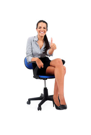 Isolated young business woman sitting approval photo