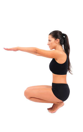 squat: Isolated young fitness woman on white