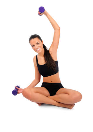Isolated young fitness woman on white photo