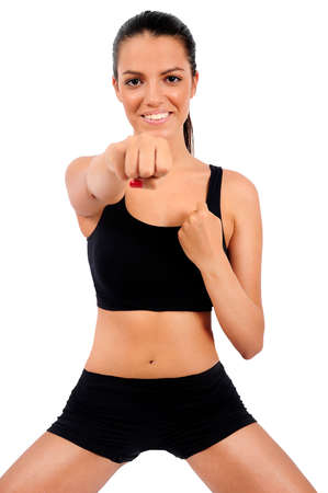 Isolated young fitness girl with focus on face photo