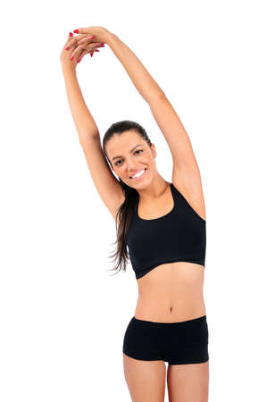 Isolated young fitness woman stretching Stock Photo - 15645974