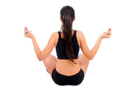Isolated young fitness woman doing yoga Stock Photo - 15645977