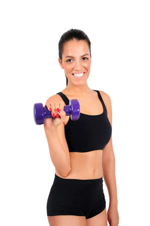 Isolated young fitness woman with dumbbell Stock Photo - 15645970
