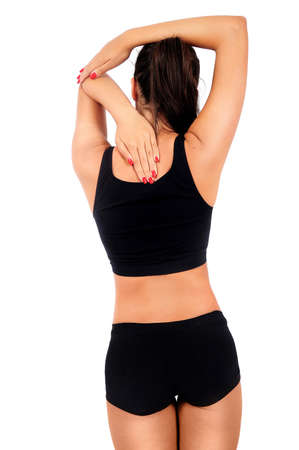 Isolated young fitness woman back touch photo