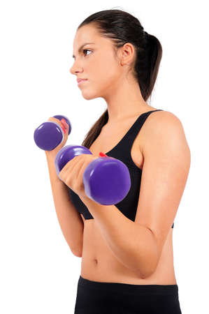 Isolated young fitness woman with dumbbell Stock Photo - 15645361