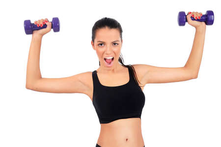 Isolated young fitness woman with dumbbell photo
