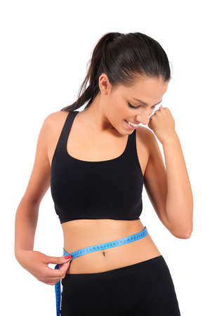 measure waist: Isolated young fitness woman successful weight loss