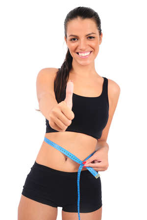 Isolated young fitness woman successful weight loss photo