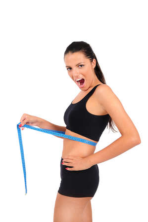 Isolated young fitness woman measuring photo