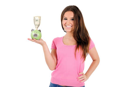 Isolated young casual woman holding piggy photo