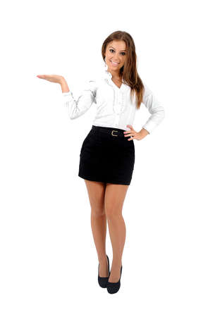 Isolated young business woman holding something photo