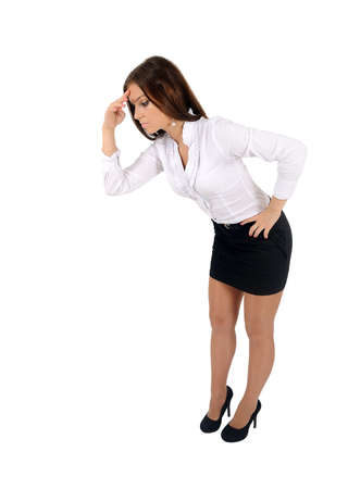bend over: Isolated young business woman looking down