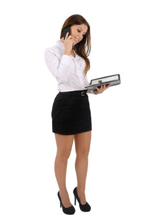 Isolated young business woman speak telephone photo