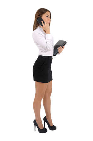 Isolated young business woman speak phone photo