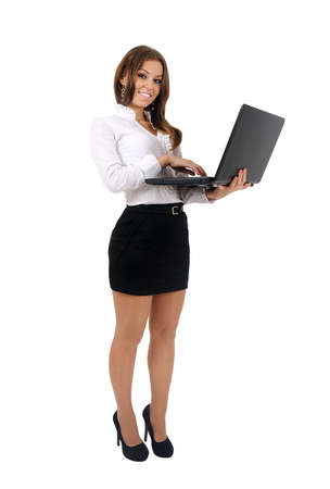 body work: Isolated young business woman using laptop Stock Photo