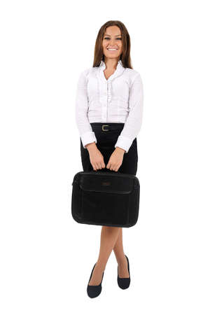 woman standing: Isolated young business woman with briefcase