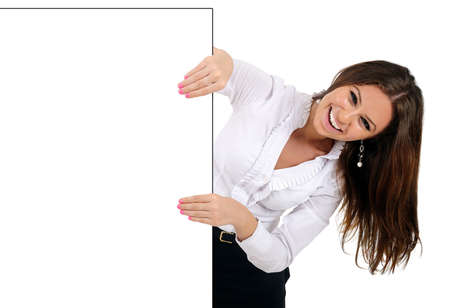 something: Isolated young business woman behind wall
