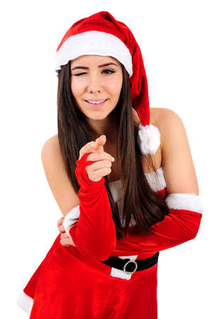 Isolated Young Christmas Girl Pointing You photo