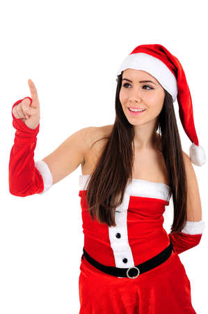 Isolated Young Christmas Girl Pointing Up photo