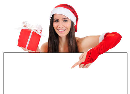 Isolated Young Christmas Girl Pointing Banner Stock Photo - 16518631