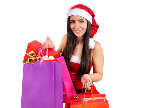 Isolated Young Christmas Girl With Shopping Bag photo