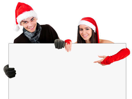 Isolated Young Christmas Couple Holding Banner photo