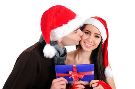 Isolated Young Christmas Couple Holding Envelope photo