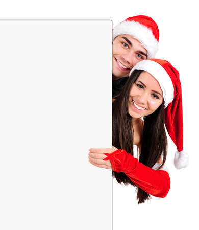 Isolated Young Christmas Couple Behind Banner Stock Photo - 16518684