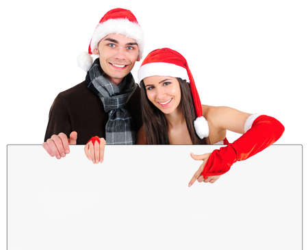 Isolated Young Christmas Couple Holding Banner Stock Photo - 16518683