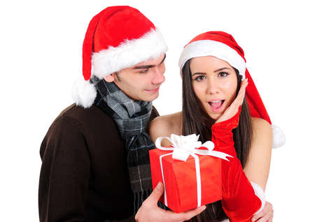 Isolated Young Christmas Couple With Gift Stock Photo - 16518701