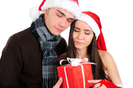 Isolated Young Christmas Couple Enjoy Gift Stock Photo - 16518702
