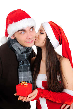 Isolated Young Christmas Couple Kiss photo