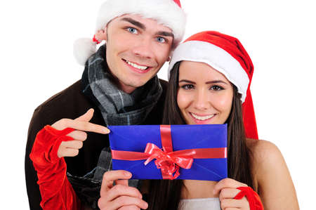 Isolated Young Christmas Couple With Envelope photo