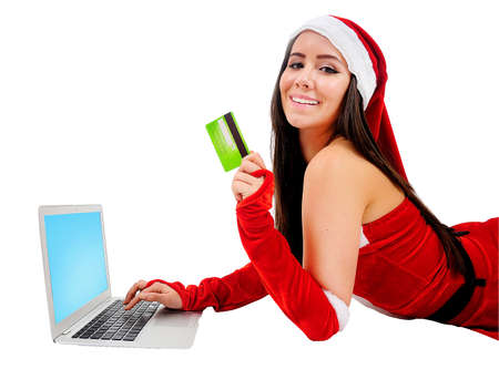 Isolated Young Christmas Girl Using Laptop photo
