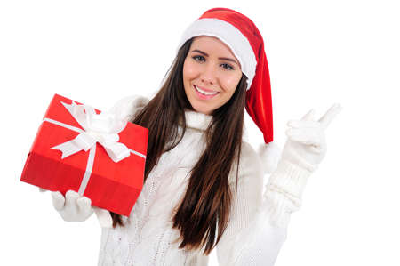 Isolated Young Christmas Girl Pointing Up Stock Photo - 16599047
