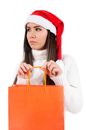 Isolated Young Christmas Girl Holding Shopping Bag photo