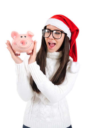 Isolated Young Christmas Girl Holding Piggy Bank photo
