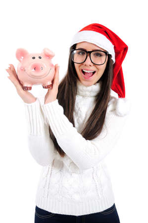 Isolated Young Christmas Girl Holding Piggy Bank Stock Photo - 16599050