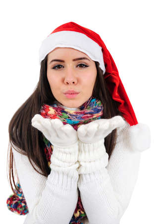 Isolated Young Christmas Girl Blowing photo