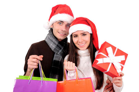 Isolated Young Christmas Couple Holding Gift Stock Photo - 16599060