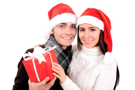 Isolated Young Christmas Couple Holding Gift photo