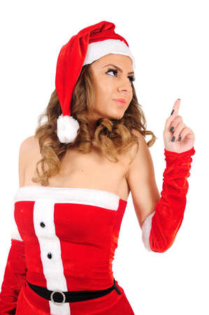 Isolated young christmas woman pointing photo