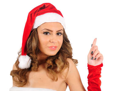 Isolated young christmas woman pointing Stock Photo - 16641131