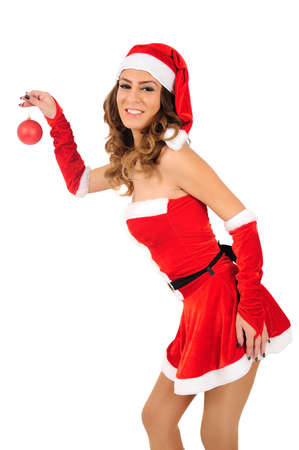 Isolated young christmas woman holding ball photo