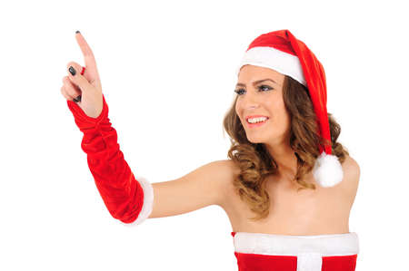 Isolated young christmas woman pointing Stock Photo - 16641215